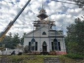 Placing the new Steeple onto the Church