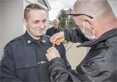 Office Scott Camacho receiving his badge at his swearing in ceremony