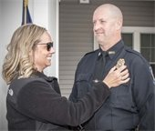Tom Ouellette receiving his badge at the swearing in ceremony.