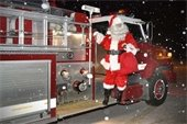 Santa arrives in a Bow Fire Truck