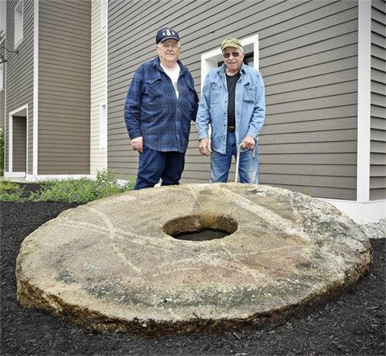 Gary Nylen and Art Cheney standing behind the Wagon Wheel Jig Stone
