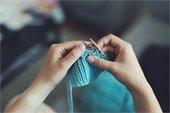 A person crocheting