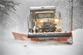 Snow Plow Plowing in the Winter