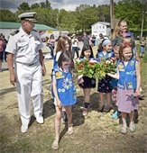 Girls Scout Carrying the Wreath before the ceremony