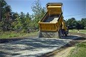 Dump truck dumpging gravel